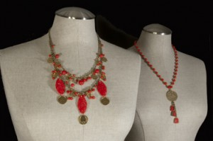 Red Show Necklaces with vintage glass and brass charms.